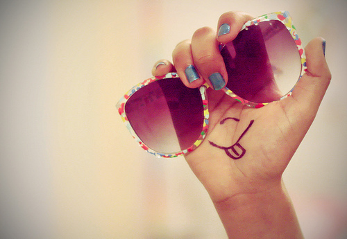 sunglasses, smiley face, hand