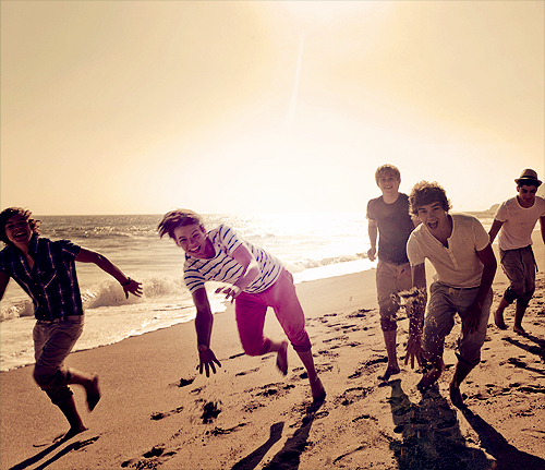 beach, boys, british, film, music video, ocean, one direction, play, sand, sepia, sunset, vintage, what makes you beautiful, wmyb